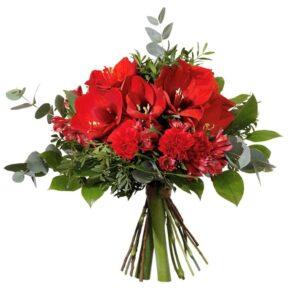 Julbukett med röda amaryllis, nejlikor, alstroemeria och gröna blad. Skicka blommorna med ett Interflora-bud, beställ enkelt online!